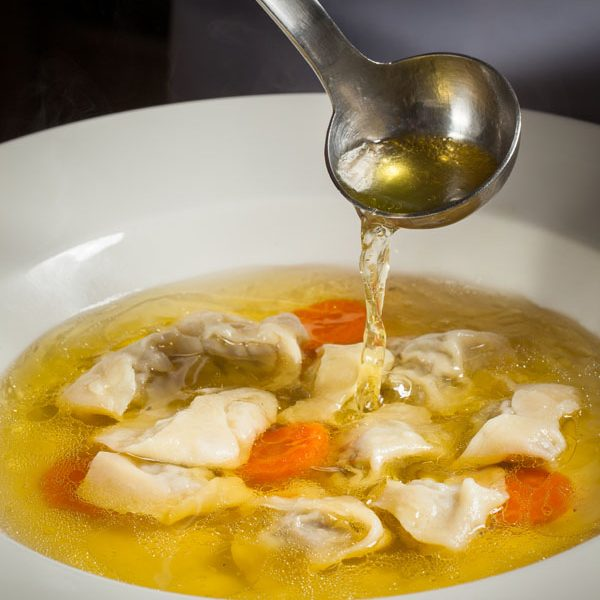 Chicken broth with meat dumplings