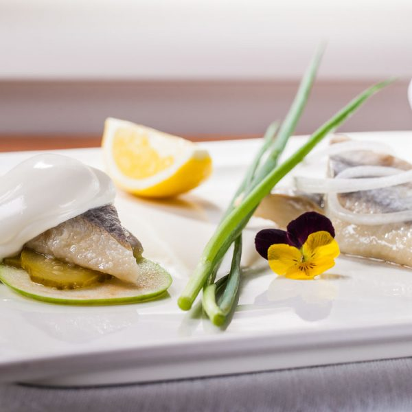 Marinated herrings served in two ways