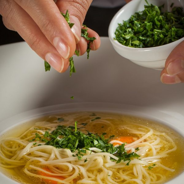 Chicken broth with meat dumplings or homemade noodles